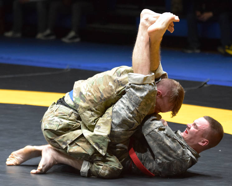 December 16, 2016 - Spc. Justin Dillon, a chemical, biological, radiological and nuclear specialist with the 101st Brigade Support Battalion, 1st Armored Brigade Combat Team, 1st Infantry Division, participates in an Army combatives tournament on Camp Casey, South Korea. Dillon, a native of Martinsburg, WV, uses combatives as one of many ways to remain resilient and emotionally strong in the face of adversity. (U.S. Army photo by Capt. Jonathan Camire, 1st ABCT Public Affairs)