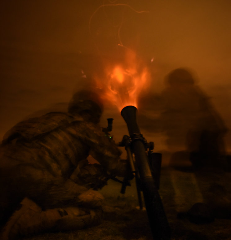 October 20, 2017 - U.S. Army Paratroopers assigned to Headquarters and Headquarters Company, 2nd Battalion, 503rd Infantry Regiment (Airborne), 173rd Airborne Brigade fire the M252A1 81mm Mortar System during a night fire range. The 173rd Airborne Brigade is the U.S. Army's Contingency Response Force in Europe, providing rapidly deploying forces to the U.S. Army Europe, Africa and Central Command Areas' of Responsibility within 18 hours. (U.S. Army photo by Staff Sgt. Alexander C. Henninger)
