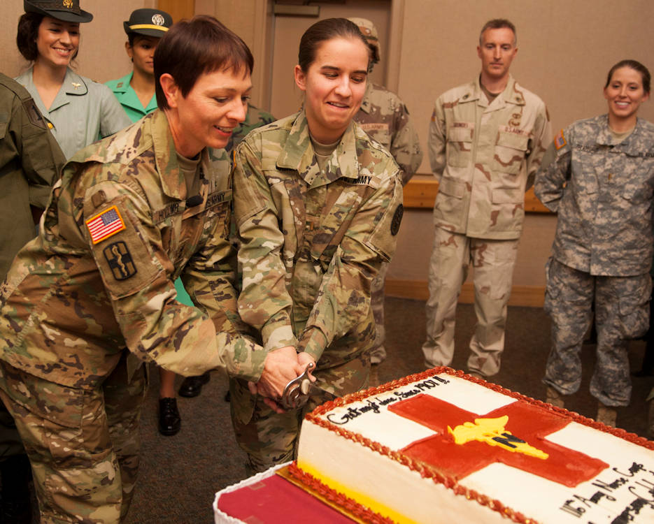 February 2, 2017 - Maj. Gen. Barbara Holcomb, chief of the U.S. Army Nurse Corps, and the youngest Army nurse in attendance, 2nd Lt. Jennifer Garcia, cut the cake to celebrate the 116th birthday of the Army Nurse Corps during a ceremony in the Brooke Army Medical Center auditorium at Fort Sam Houston, Texas. (U.S. Army photo by James Camillocci)