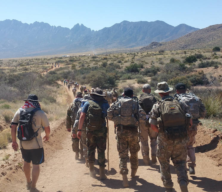 March 19, 2017 - Participants in the Bataan Memorial Death March trek through the desert of White Sands Missile Range, New Mexico. The Bataan Memorial Death March commemorates the infamous 65-mile forced march of more than 60,000 American and Filipino troops during World War II (U.S. Air National Guard photo by Tech. Sgt. Michael Matkin)