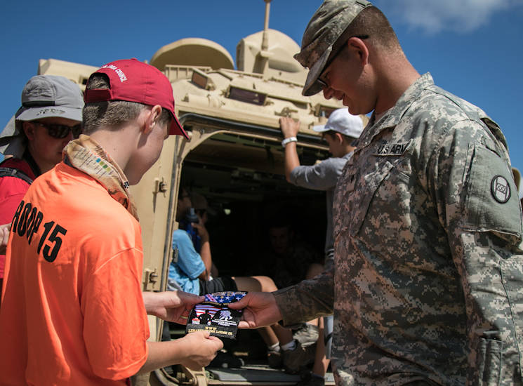 July 21, 2017 - Spc. Dakota Sayre, a Soldier with the West Virginia Army National Guard's C Troop, 1-150th Cavalry, awards a Wounded Warrior Project patch to a boy scout during the BSA 2017 National Jamboree at the Summit Bechtel Reserve near Glen Jean, West Virginia. The 2017 National Jamboree is being attended by 30,000 Boy Scouts, troop leaders, volunteers and professional staff members, as well as more than 15,000 visitors. Approximately 1,200 military members from the Department of Defense and the U.S. Coast Guard are providing logistical support for the event. (U.S. Army photo by Spc. Liem Huynh, 22nd Mobile Public Affairs Detachment)