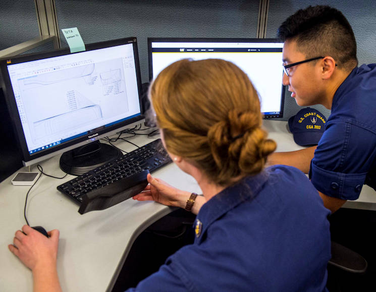 October 13, 2016 - Cadet Jennifer Haley and Cadet Samuel Park discuss  the design process of their naval architecture capstone project at the U.S. Coast Guard Academy. Applying their study of engineering principles, the cadets will present solutions for replacing the inland waterway fleet prior to their graduation. (U.S. Coast Guard photo by Petty Officer 3rd Class Nicole Barger)