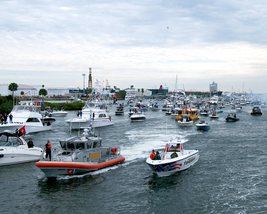 January 28, 2017 - A 45-foot Response Boat-Medium boat crew from Coast Guard Station St. Petersburg and a Hillsborough County Sheriff's Office marine unit maintain a safety zone during the Jose Gasparilla Pirate Invasion in Tampa Bay. The Coast Guard partnered with multiple local agencies to ensure the safety and security of boaters during the event. (U.S. Coast Guard photo by Petty Officer 2nd Class Ashley J. Johnson)