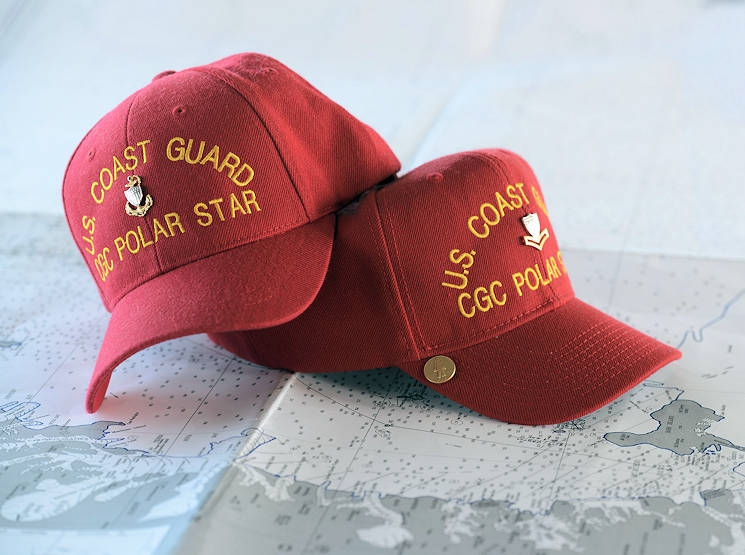 January 10, 2017 - A pair of Coast Guard Cutter Polar Star red hats sit on a chart of the coast of Antarctica. The wearing of a red ball cap aboard a Coast Guard icebreaker is a tradition that was started in the 1970's. (U.S. Coast Guard photo by Chief Petty Officer David Mosley)