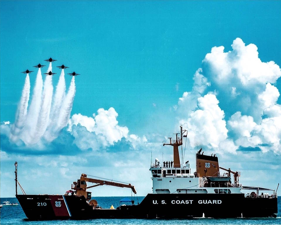 U.S. Coast Guard Cutter Cypress (WLB-210) serves as the center point during a U.S. Navy Blue Angels performance at the 2017 Pensacola Beach Air Show. The Blue Angels and Cypress forged an enduring relationship after Cypress hoisted a 30,000-pound Blue Angels F/A-18 off the seafloor. The pilot safely ejected. Cypress maintains buoys and beacons that help to keep Gulf Coast mariners and the U.S. maritime economy on course. (U.S. Coast Guard courtesy photo)