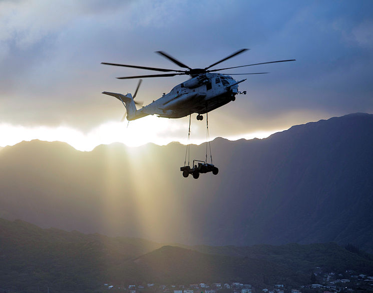 March 8, 2017 - A CH-53E Super Stallion helicopter assigned to Marine Heavy Helicopter Squadron 463, carried a Humvee during an external lift training at Landing Zone West Field aboard Marine Corps Air Station Kaneohe Bay. This training improves proficiency for the pilots when moving supplies while Marines on the ground conditioned themselves to safely prepare dual and single load lifts. (U.S. Marine Corps photo by Cpl. Jesus Sepulveda Torres)