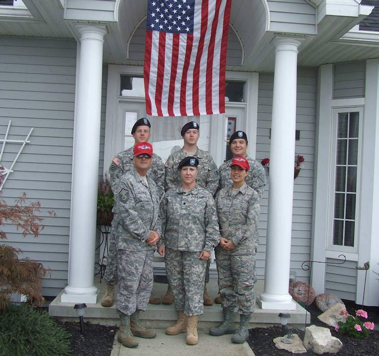 March 17, 2017 - Members of the Clemens Family, with more than 120 years of military service, stand in front of the Family home in Port Clinton, Ohio after three of them returned from overseas deployments. Pictured are retired Senior Master Sgt. Ken Clemens (clockwise from front row, left), Col. Barb Herrington-Clemens, Capt. Chelsea Migura, Staff Sgt. Rich Clemens, Staff Sgt. Drew Clemens and Sgt. 1st Class Zach Migura. (Ohio National Guard courtesy photo)
