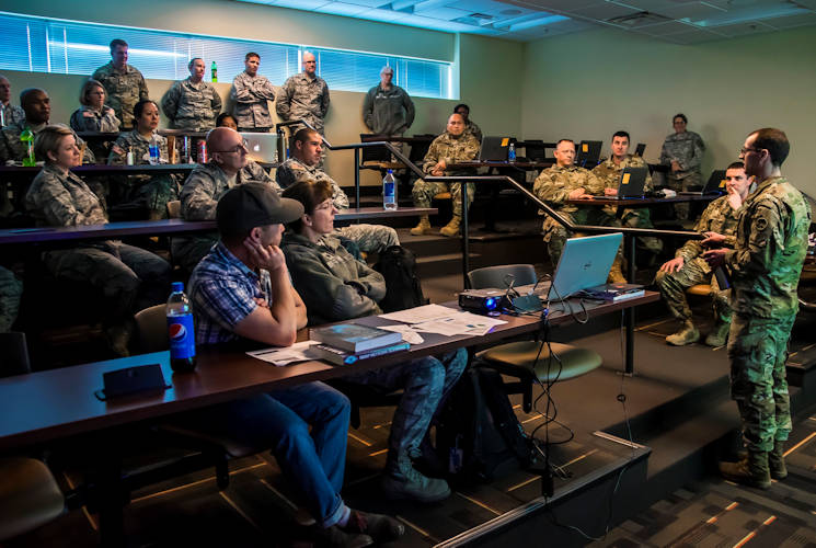 February 12, 2017 - Chief Warrant Officer 2 Johnston (first name removed for security), of the Colorado National Guard's Defensive Cyber Operations Element, provides a briefing to the Joint Task Force - Centennial, about what the Vital Connection cyber exercise tests for and the overall process, at the Regis University training center in Greenwood Village, Colorado. (U.S. Air National Guard photo by Maj. Darin Overstreet)