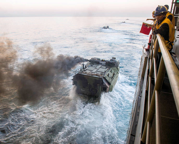 October 27, 2017 - An amphibious assault vehicle (AAV) departs the well deck of the San Antonio-class amphibious transport dock ship USS Anchorage (LPD 23) during the assault evolution of Dawn Blitz 2017. Dawn Blitz is a scenario-driven amphibious exercise designed to train and integrate Navy and Marine Corps units by providing a robust training environment where forces plan and execute an amphibious assault, engage in live-fire events, and establish expeditionary advanced bases in a land and maritime threat environment to improve naval amphibious core competencies. (U.S. Navy photo by Mass Communication Specialist 3rd Class Abby Rader)