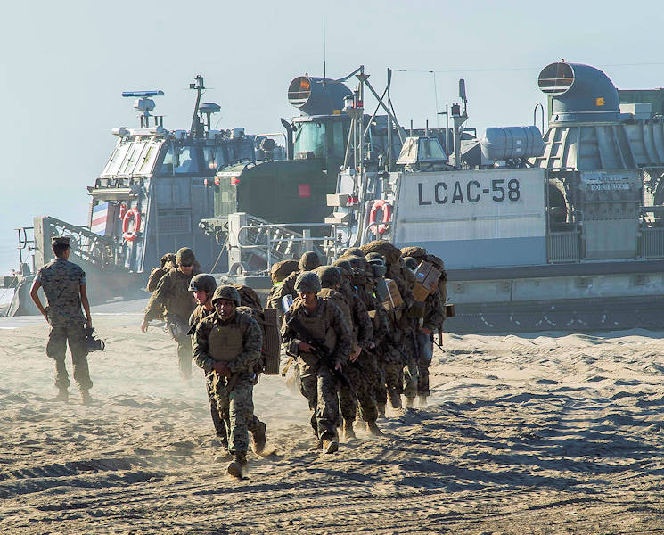 October 27, 2017 - U.S. Marines disembark a landing craft air cushion (LCAC) to begin the Red Beach tactical maneuvering portion of the bilateral exercise Dawn Blitz 2017. Dawn Blitz 2017 is a scenario-driven amphibious exercise designed to train and integrate Navy and Marine Corps units by providing a robust training environment where forces plan and execute an amphibious assault, engage in live-fire events, and establish expeditionary advanced bases in a land and maritime threat environment to improve naval amphibious core competencies. (U.S. Navy photo by Mass Communication Specialist Seaman Apprentice Jailene Casso)