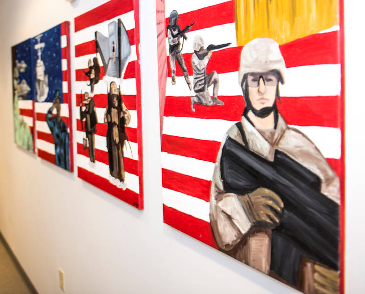 October 23, 2017 - Soldiers' paintings honoring the four military services adorn the walls at the Joint Personal Effects Depot located at Dover Air Force Base in Delaware. Soldiers working at the JPED take a great deal of pride in honoring the fallen. They go through great lengths to ensure all of a fallen service members' personal effects are cleaned and accounted for before returning them back to the families. (U.S. Army photo by Master Sgt. Brian Hamilton)
