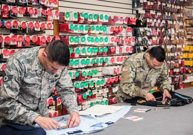 October 24, 2017 - Air Force Staff Sgt. Giuseppe Francioni (left) and Army Reserve Staff Sergeant Luis Diaz (right) assemble the dress uniforms of their respective services for use during mortuary affairs operations at the Charles C. Carson Center, located at Dover Air Force Base in Dover, Del., Oct. 24, 2017. The Charles C. Carson Center is home to the Port Mortuary which is responsible for returning all Department of Defense service members, civilians, and contractors who perish during contingency operations overseas. The 73,000 square foot facility was built in 2003 at a cost of $30 million. (U.S. Army photo by Master Sgt. Brian Hamilton)