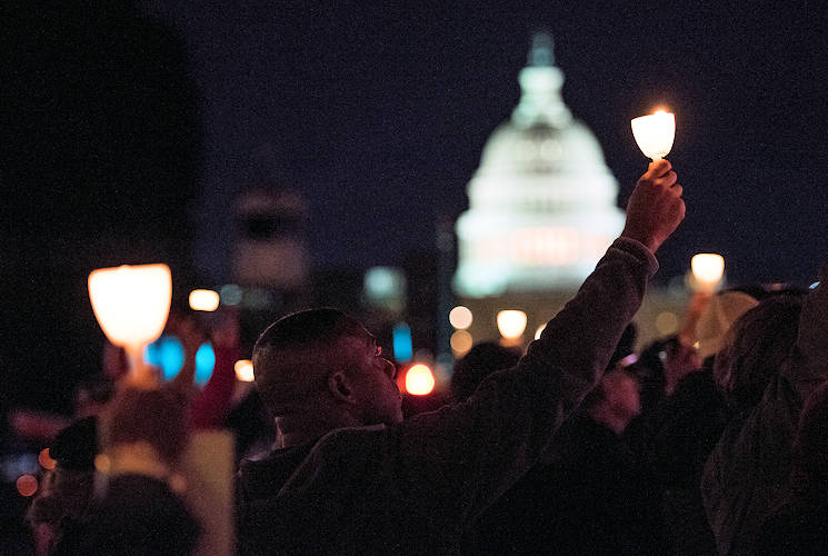 May 13, 2017 - Police officers and family members raise candles during the 29th Annual Candlelight Vigil honoring fallen police officers from around the country on the National Mall in Washington, D.C., May 13, 2017. Approximately 300 police officers' names were read, engraved into the National Police Memorial. Among those names was Staff Sgt. James D. McNaughton, a U.S. Army Reserve military police who was the first New York City police officer killed in action while deployed to Iraq, Aug. 2, 2005. (U.S. Army Reserve photo by Sgt. Audrey Hayes)