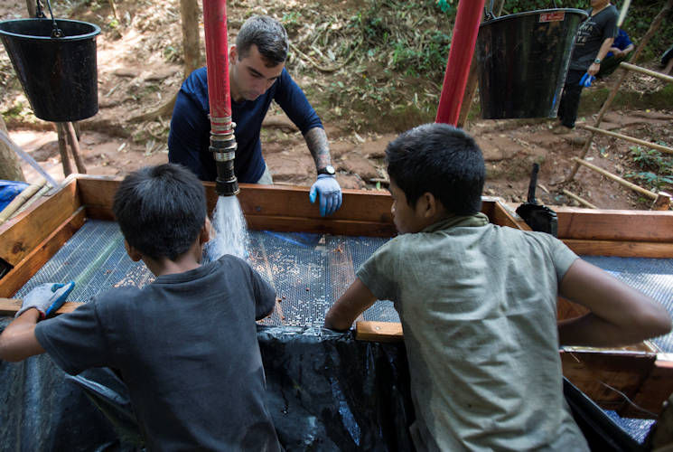 May 24, 2017 - U.S. Army Sgt. Christopher Ausborn, a recovery non-commissioned officer with the Defense POW/MIA Accounting Agency (DPAA) screens soil for possible evidence during a DPAA mission to recover fallen service members from the Vietnam War in Khammouan Province, Laos. The mission of DPAA is to provide the fullest possible accounting for our missing personnel to their families and to the nation. (U.S. Marine Corps photo by MCIPAC Combat Camera Lance Cpl. Brooke Deiters)