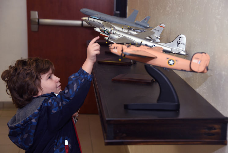 November 15, 2017 - Grayson Westeman, 344th Air Refueling Squadron Pilot-for-a-Day, spins model plane propellers at McConnell Air Force Base, Kansas. During the tour, Westeman, a 3-year-old battling Leukemia, toured a KC-135 Stratotanker, piloted a KC-135 simulator and was presented with mementos from the 344th ARS(U.S. Air Force photo by Airman 1st Class Alan Ricker)