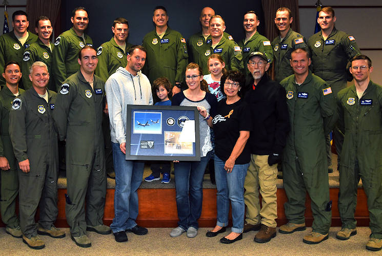 November 15, 2017 - Grayson Westeman, 344th Air Refueling Squadron Pilot-for-a-Day, and his family with Airmen assigned to the 344th ARS at McConnell Air Force Base, Kansas. The 344th ARS presented a plaque and a coin to Westeman, a 3-year-old who is battling Leukemia. (U.S. Air Force photo by Airman 1st Class Alan Ricker)