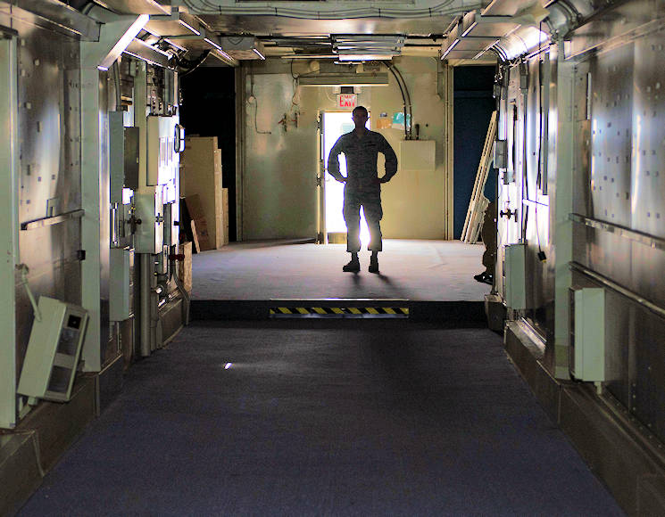 "July 10, 2017 - Tech. Sgt. Benjamin Whitfield, 92nd Air Refueling Wing historic property custodian, stands in the cavernous hull of ""Little John"", a former KC-135 simulator at Fairchild Air Force Base, Washington. The KC-135 and B-52 were often used together on missions, so training often occurred in the same place. (U.S. Air Force photo by Airman 1st Class Ryan Lackey)"