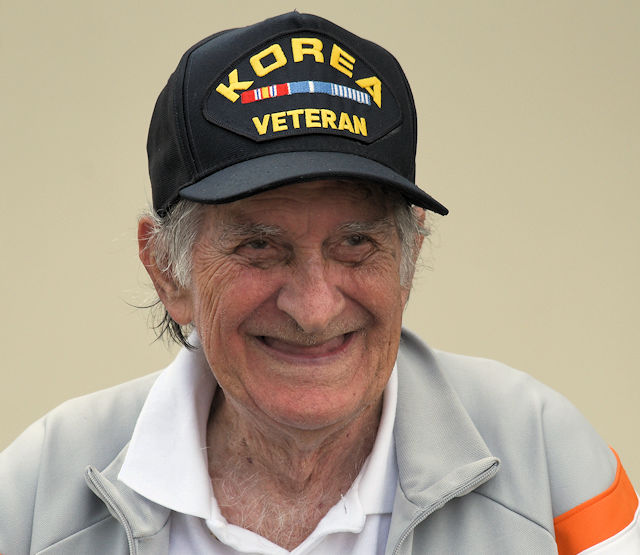 April 23, 2017 - Eugene Downey, a U.S. Navy Korean War veteran smiles while watching the 2017 Gulf Coast Salute on the Tyndall Air Force Base flight line in Florida. Downey enlisted in the Navy in 1948 and received the rank of ensign in 1951, enabling him to become a pilot. (U.S. Air Force photo by Senior Airman Solomon Cook)