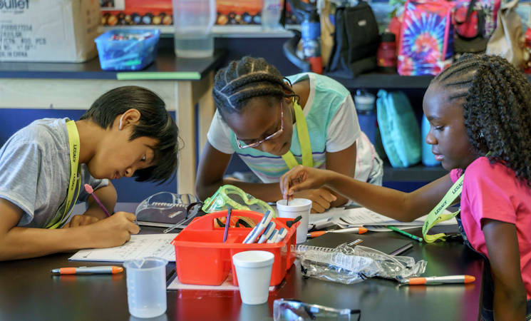 June 19, 2017 - LEGACY (Leadership Experience Growing Apprenticeships Committed to Youth) students enjoy a group activity as part of the program's Craftsman camp events. AFRL Materials and Manufacturing Directorate volunteers participated in the camps this summer to promote youth interest in STEM-related fields. (U.S. Air Force photo by Kwame Acheampong, AFRL)