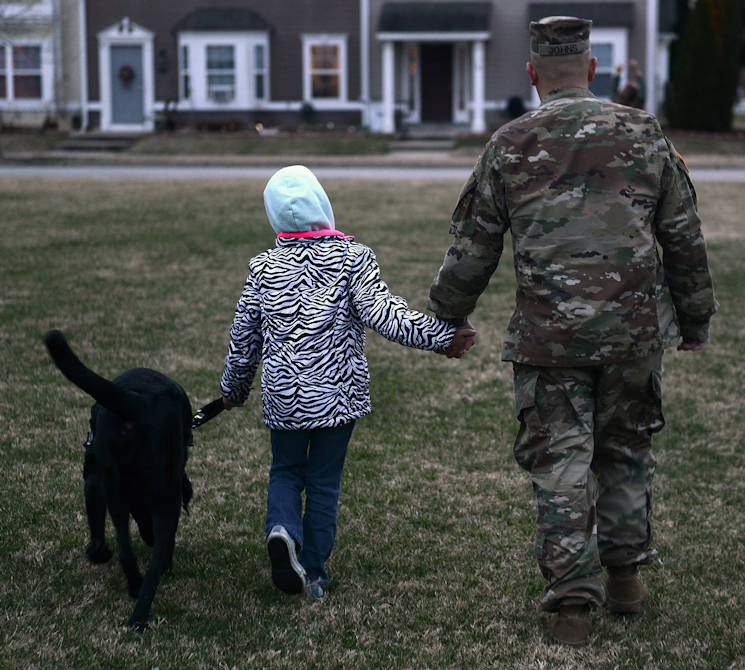 January 5, 2017 - U.S. Army Sgt. Matthew Johns, 221st Military Police Detachment military police officer, and his daughter AudreeAna, age six, walk her service dog, Hope, at Joint Base Langley-Eustis, VA.. Before arriving to JBLE due to a permanent change of station, the Johns family worked with the Exceptional Family Member Program, a mandatory program for all active-duty service members with special needs family members. (U.S. Air Force photo by Staff Sgt. Teresa J. Cleveland)