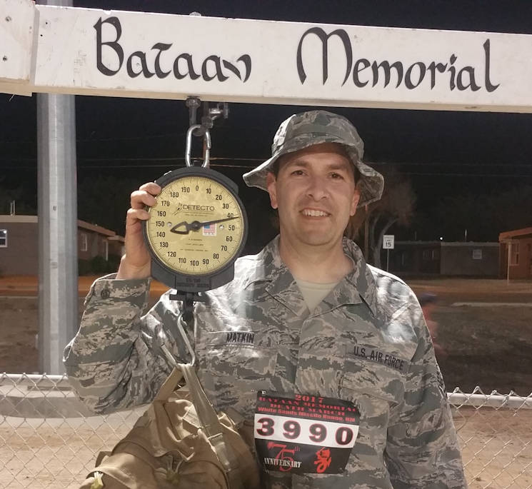 March 19, 2017 - Tech. Sgt. Michael Matkin poses while weighing his pack before the Bataan Memorial Death March, White Sands Missile Range, New Mexico. The Bataan Memorial Death March commemorates the infamous 65-mile forced march of more than 60,000 American and Filipino troops during World War II. (Photo provided by U.S. Air National Guard Tech. Sgt. Michael Matkin)