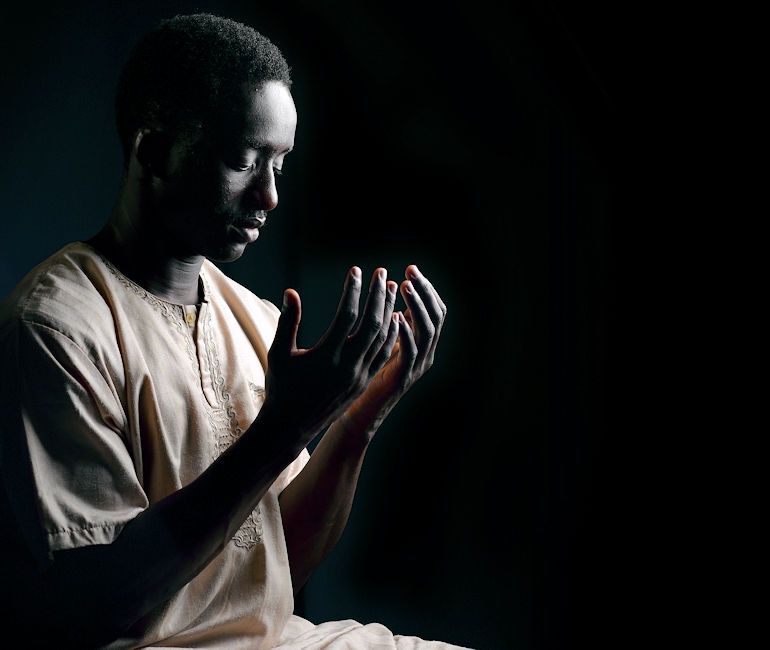 August 3, 2017 - Personnel Specialist 3rd Class Mamadou Mbengue, a native of Senegal, Africa, gets ready to conduct his daily prayer aboard the aircraft carrier USS Nimitz (CVN 68) while on deployment. Nimitz is conducting a docking planned incremental availability at Puget Sound Naval Shipyard and Intermediate Maintenance Facility where the ship will receive scheduled maintenance and upgrades. (U.S. Navy photo by Mass Communication Specialist 3rd Cody M. Deccio)