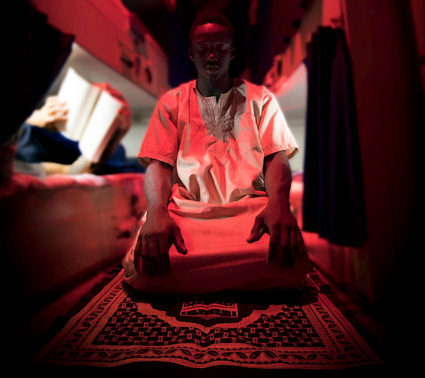 August 11, 2017 - Personnel Specialist 3rd Class Mamadou Mbengue, a native of Senegal, Africa, conducts his final prayer for the day in his berthing aboard the aircraft carrier USS Nimitz (CVN 68) while on deployment. Nimitz is conducting a docking planned incremental availability at Puget Sound Naval Shipyard and Intermediate Maintenance Facility where the ship will receive scheduled maintenance and upgrades. (U.S. Navy photo by Mass Communication Specialist 3rd Class Cody M. Deccio)