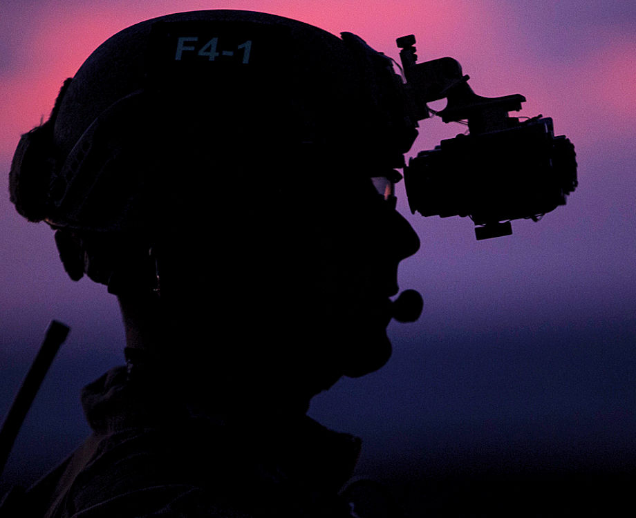 A Marine with the 31st Marine Expeditionary Unit's force reconnaissance platoon waits on the flight deck before low-light fast rope training aboard the USS Bonhomme Richard in the Pacific Ocean, June 25, 2017. The new Binocular Night Vision Goggle II being fielded by Marine Corps Systems Command will give force recon and explosive ordnance disposal Marines improved depth perception and better situational awareness on night missions. (U.S. Marine Corps photo by Staff Sgt. T. T. Parish)