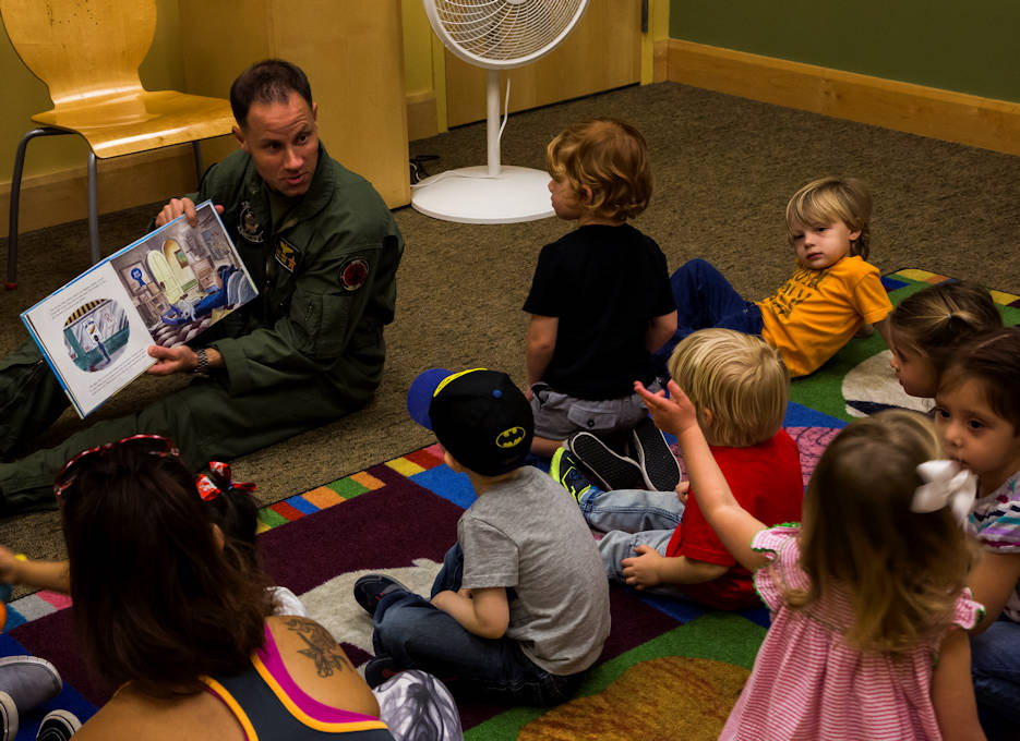 "February 15, 2017 - U.S. Marine Corps Maj. Benjamin D. Apple, the operations officer for Marine Fighter Training Squadron 401 (VMFT-401), stationed out of Marine Corps Air Station Yuma, Ariz., reads ""Violet Pilot,"" an aviation-themed children's book to families at the main Yuma County Library. (U.S. Marine Corps photo by Lance Cpl. Christian Cachola)"