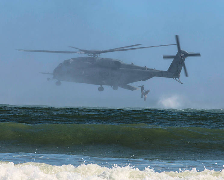 October 19, 2017 - U.S. Marines jump from a CH-53 Super Stallion during a helocast exercise at Marine Corps Base Camp Lejeune, NC. Bold Alligator 17 is a large-scale, multinational amphibious exercise designed to execute complex shaping operations, amphibious landing and attack, and sea basing operations to improve U.S. and coalition ship-to-shore capabilities. (U.S. Marine Corps photo by Lance Cpl. Ashley McLaughlin)