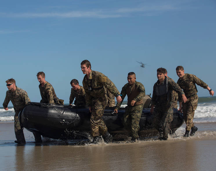 October 19, 2017 - U.S., Royal, and Mexican Marines bring a Zodiac combat rubber raiding craft to shore during a helocast exercise at Marine Corps Base Camp Lejeune, NC. Bold Alligator 17 is a large-scale, multinational amphibious exercise designed to execute complex shaping operations, amphibious landing and attack, and sea basing operations to improve U.S. and coalition ship-to-shore capabilities. (U.S. Marine Corps photo by Lance Cpl. Ashley McLaughlin)