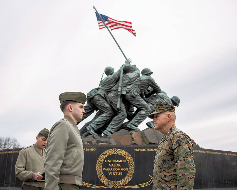 February 3, 2017 - Commandant of the Marine Corps Gen. Robert B. Neller, right, stands at the position of attention during the reading of a promotion warrant for Staff Sgt. Stephen E. McDonald, defense cyber network noncommissioned officer in charge, at the Marine Corps War Memorial, Arlington, VA. McDonald was promoted to Staff Sgt. after eight years of service in the U.S. Marine Corps. (U.S. Marine Corps photo by Cpl. Samantha K. Braun)