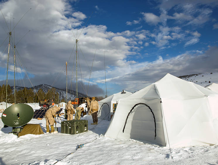 "January 18, 2016 - Marines with 2nd Battalion, 2nd Marine Regiment, set up communication equipment in a tent city located in the Grouse Meadows training area during Mountain Training Exercise 1-17 in the vicinity of the Marine Corps Mountain Warfare Training Center Bridgeport, California. MCMWTC is one of the Marine Corps' most secluded posts, comprised of approximately 46,000 acres of terrain with elevations ranging from 5,000 to 11,000 feet. During this iteration of MTX, the inclusion of the Artic Tent, designed to house up to 15 personnel, enabled the ""Warlords"" to be truly immersed in the frigid landscape throughout the full duration of the training. (U.S. Marine Corps photo by Cpl. Levi Schultz)"