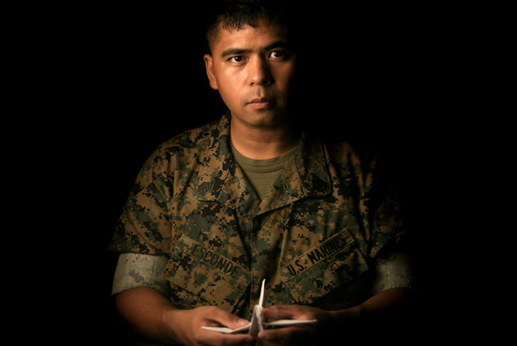 April 19, 2017 - Staff Sgt. Ismael Esconde, the substance abuse control officer with Headquarters and Service Company, 3rd Battalion, 3rd Marine Regiment, holds an origami crane that he folded at building 267 aboard Marine Corps Base Hawaii. Esconde uses origami as a way to make a positive impact in his local community. (U.S. Marine Corps photo by Sgt. Brittney Vella)
