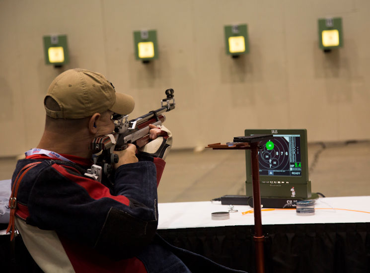 June 29, 2017- U.S. Marine Corps Staff Sgt. James Dunaway sights in on his target during a 2017 DoD Warrior Games shooting practice at McCormick Place in Chicago, IL Dunaway, a native of Tampa, Florida., is a member of Team Marine Corps. The Warrior Games is an adaptive sports competition for wounded, ill and injured service members and veterans. (U.S. Marine Corps photo by Lance Cpl. Nadia J. Stark)