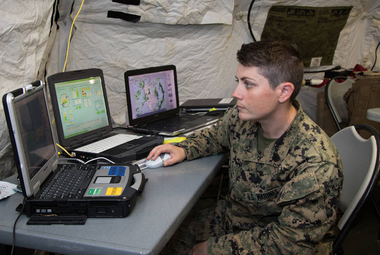 November 17, 2017 - Marine Staff Sgt. Rachael Parkison, Marine Tactical Operations Center chief for the Aguadilla radar station, surveys weather radar data streaming from her team's X band expeditionary radar system in Aguadilla, Puerto Rico. Marines serving with the Marine Air Control Squadron 2 set up the system in order to bring radar services back to the island following Hurricane Maria. The hurricane destroyed all National Weather Service weather radar systems in Puerto Rico, and may take up to six months to repair. In the interim, the MACS 2 Marines will continue to fill the data gap with their two radar sites. (U.S. Army photo by Staff Sgt. Evan Lane)