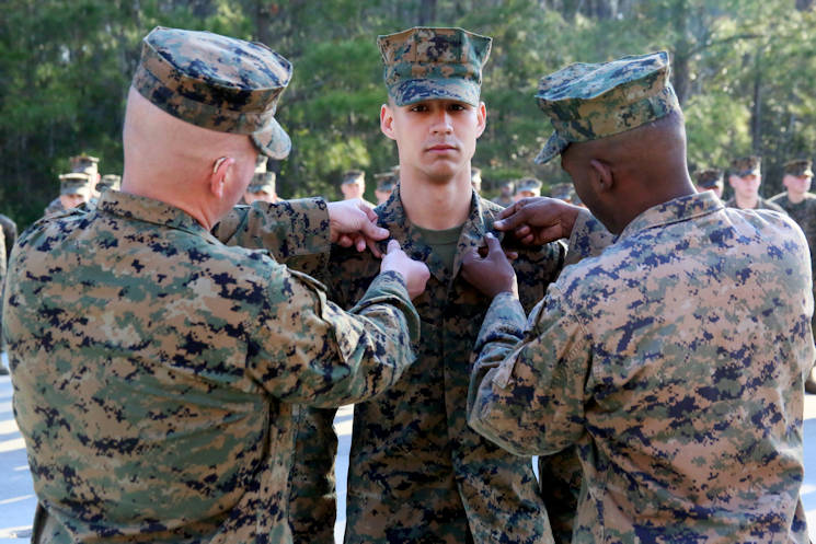 February 2, 2017 - Sgt. Ryan Tugas, center, is pinned as a meritorious sergeant during a promotion ceremony aboard Marine Corps Air Station Cherry Point, N.C. Marine Tactical Air Command Squadron 28's senior leadership recognized Tugas for going above and beyond the call of duty while assigned as the assistant motor transport operations chief. Tugas is a motor transport operator assigned to MTACS-28, Marine Air Control Group 28, 2nd Marine Aircraft Wing. (U.S. Marine Corps photo by Cpl. Mackenzie Gibson)