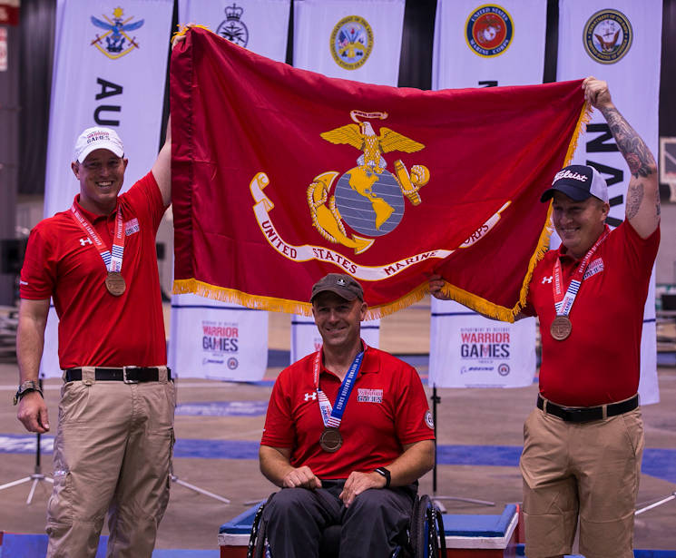 July 3, 2017 - U.S. Marine Corps Staff Sgt. James Dunaway, left, U.S. Marine Corps Gunnery Sgt. Douglas Godfrey, center, and U.S. Marine Corps Sgt. Jacob Greenlief, right, after winning the bronze medal during the 2017 DoD Warrior Games Archery Competition at McCormick Place in Chicago. Dunaway, a native of Tampa, Fla., Godfrey, a native of Woodbridge, Va., and Greenlief, a native of Kirkwood, Ill., are members of Team Marine Corps. The DoD Warrior Games is an adaptive sports competition for wounded, ill and injured service members and veterans. (U.S. Marine Corps photo by Lance Cpl. Juan Madrigal)