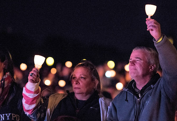 May 13, 2017 - William and Michele McNaughton from, Centereach, New York, raise lit candles as their son's name, Staff Sgt. James D. McNaughton, is read during the 29th Annual Candlelight Vigil on the National Mall in Washington, D.C. McNaughton was a U.S. Army Reserve military police who was the first New York City police officer killed in action while deployed to Iraq, Aug. 2, 2005. Approximately 300 police officers' names were read, engraved into the National Police Memorial. (U.S. Army Reserve photo by Sgt. Audrey Hayes)