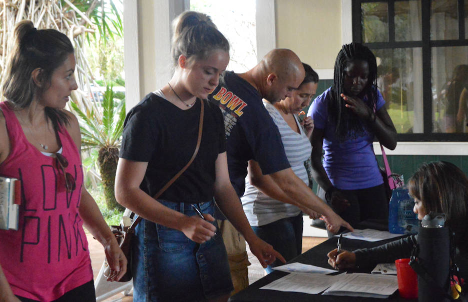January 18, 2017 - Teens and parents sign in to the Teen Job Fair at the Kalakaua Community Center on Schofield Barracks. (U.S. Army photo by Karen A. Iwamoto, Oahu Publications)