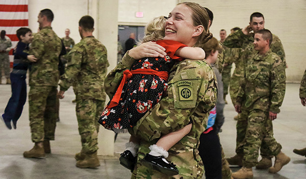 A U.S. Army soldier embraces her daughter during a homecoming ceremony on Pope Army Airfield Green Ramp. (U.S. Army photo by Sgt. William Begley)
