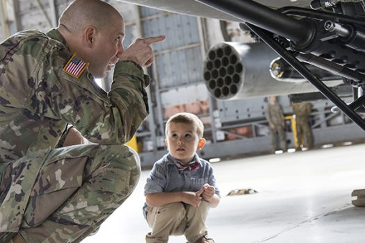 U.S. Army Col. Jeff A. Becker captures the attention of a little boy before a welcome home ceremony on Hunter Army Airfield. (U.S. Army photo by Sgt. William Begley)