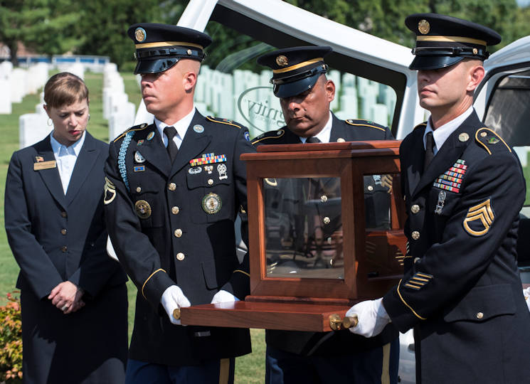 "The remains of U.S. Army Air Forces Staff Sgt. William ""Blootie"" Turner are transferred from funeral coach to the memorial garden, during the interment service for Turner, August 22, 2017, at the Nashville National Cemetery located in Madison, Tenn. Turner was aboard a B-26 Marauder in December 1943, when the plane, nicknamed ""Hell's Fury,"" was shot down killing all on board except the pilot. After years of painstaking work, Turner's remains were positively identified and he was given proper military burial honors. (U.S. Army photo by Master Sgt. Brian Hamilton)"