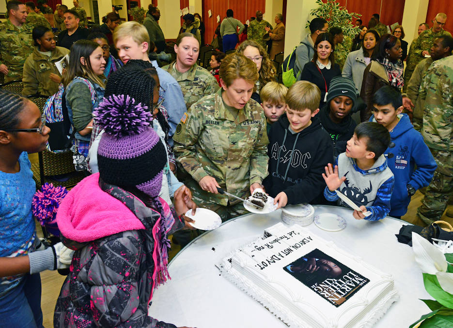 January 10, 2017 - Colonel Christine A. Beeler, commander of the U.S. Army 414th Contracting Support Brigade, serves cake to children, during Martin Luther King, Jr. Day observance, at Vicenza Military Community's 2017 Observance Ceremony at Caserma Ederle, Vicenza, Italy. (U.S. Army photo by Visual Information Specialist Paolo Bovo)