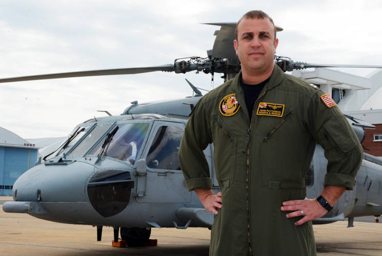 "April 14, 2017 - Lt. Adam Patterson stands in front of one of the MH-60S Helicopters he flies as a pilot with NAS Patuxent River's Search and Rescue team, the NAS Patuxent River ""SAR Dogs."" Patterson's Navy career has taken him above and below the sea, starting with him as an enlisted submariner and taking him to the heights of naval aviation. (U.S. Navy photo by Petty Officer 1st Class Patrick Gordon)"