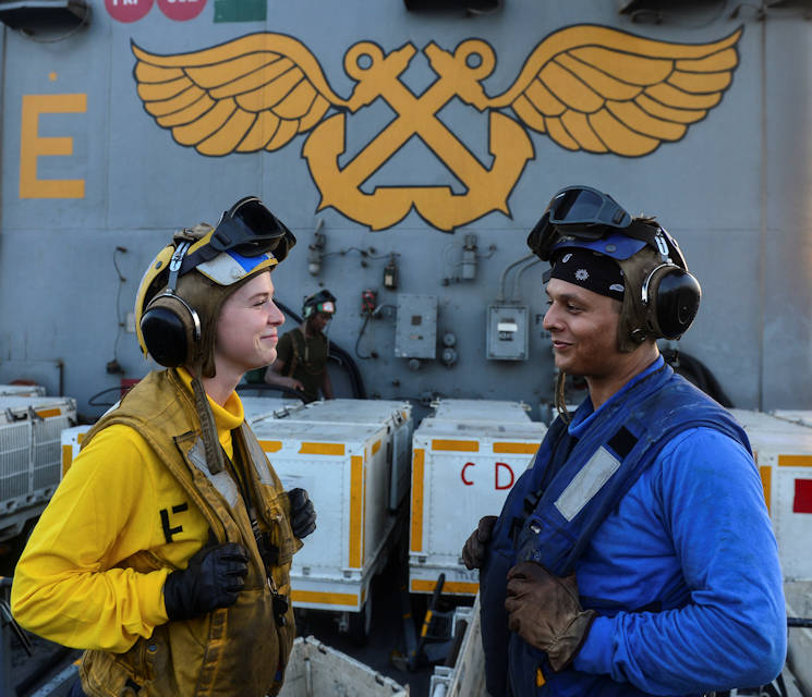 August 4, 2017 - U.S. Navy Aviation Boatswain's Mate (Handling) 3rd Class Melanie Cluck, from Palm Springs, Calif., and Airman Michael Lathrop, from Atlanta, poses for a photo aboard the aircraft carrier USS Nimitz (CVN 68) in the Arabian Gulf. Nimitz is deployed in the U.S. 5th Fleet area of operations in support of Operation Inherent Resolve. While in this region, the ship and strike group are conducting maritime security operations to reassure allies and partners, preserve freedom of navigation, and maintain the free flow of commerce. (U.S. Navy photo by Mass Communication Specialist 3rd Class Ian Kinkead)
