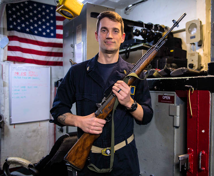 January 19, 2017 - Senior Chief Gunner's Mate James Hoppa, from Waupaca, Wisconsin, with a rifle in the armory of the amphibious assault ship USS Bataan (LHD 5). The ship is underway conducting Composite Training Unit Exercise (COMPTUEX) with the Bataan Amphibious Ready Group in preparation for an upcoming deployment. (U.S. Navy photo by Petty Officer 3rd Class Evan Thompson)