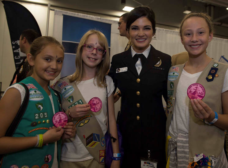 October 7, 2017 - Lieutenant Junior Grade Kellie Hall, a recruiter at Navy Recruiting District Ohio, gives limited edition Navy patches to Girl Scouts at G.I. R.L. (Go-getter, Innovator, Risk-taker, and Leader) 2017 in Columbus, Ohio. (U.S. Navy photo by Mass Communication Specialist 3rd Class Brandon Woods)