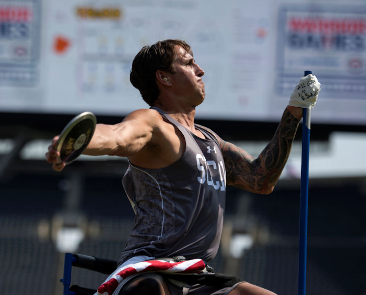 July 5, 2017 - Lt. Cmdr Ramesh Haytasingh throws seated discus in the 2017 Dept. of Defense Warrior Games in Chicago. An inscription on the tape holding his hand to support pole reads 'All Gas No Brakes.' The DoD Warrior Games are an annual event allowing wounded, ill and injured service members and veterans to compete in Paralympic-style sports. (DoD photo by EJ Hersom)