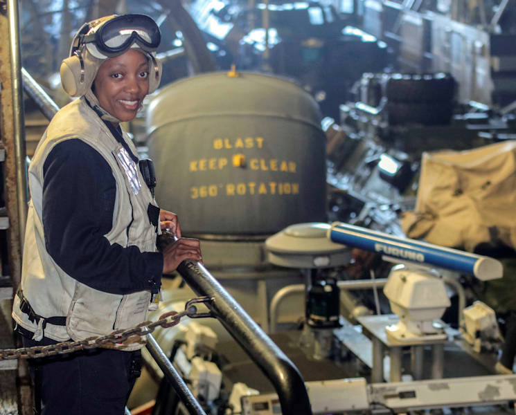March 9, 2017 - Chief Warrant Officer (CWO) 2 Summer Levert, a Cleveland native, poses for a photo in the well deck aboard amphibious transport dock ship USS Mesa Verde (LPD 19). Levert is the Navy's first black female CWO Bos'n, the subject matter expert on all major seamanship functions and the maintenance of topside gear such as; small boat operations, supervising anchoring, mooring, and replenishment-at-sea and the operation and maintenance of the ship's boats. The ship is deployed with the Bataan Amphibious Ready Group to support maritime security operations and theater security cooperation efforts in the U.S. 6th Fleet area of operations. (U.S. Navy photo by Mass Communication Specialist 2nd Class Brent Pyfrom)